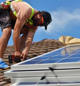 Solar panels being installed on a house in Sydney.